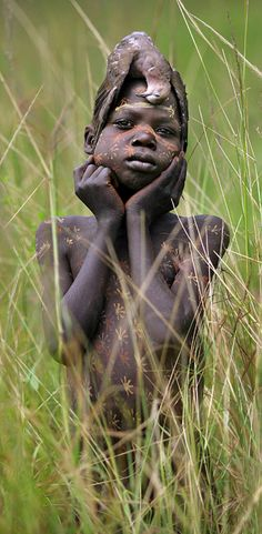 Africa | Suri child.  Omo Valley, southern Ethiopia || ©Timothy Allen