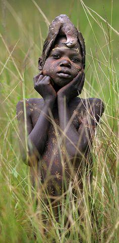 Africa | Suri child.  Omo Valley, southern Ethiopia || ©Timothy Allen