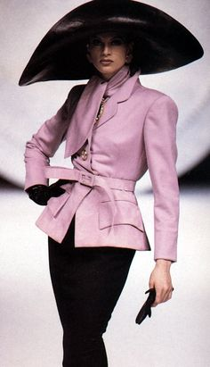 House of Dior. Pink/mauve jacket with tie. No hat.