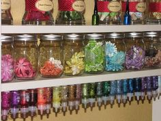 Great idea for a craft room etc. The glitter paints (etc) are hung up-side down with velcro.