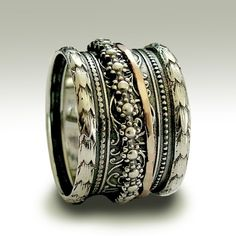 Sterling silver woodland wedding band with silver and gold spinners - It's okay to believe. $178.00, via Etsy.