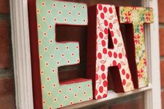 inspired by the EAT letters hanging in jules kitchen on the TV show cougar town. these cute funky EAT decoupage letters are that fabulous
