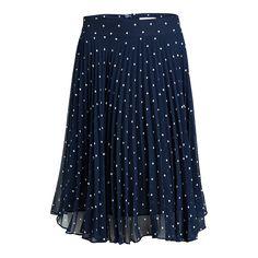 En feminin och flirtig kjol full av små vita prickar mot en marinblå  botten. Den e62fe3b4fe0bf