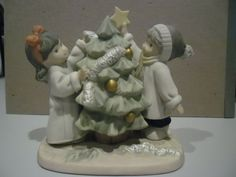 Aww this cake out the year dan and I what about our first Christmas!   ENESCO 2001 Figurine Our Holiday Is Trimmed With Love  | eBay