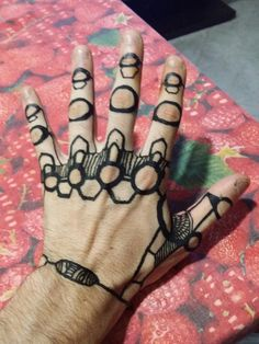 Black henna tattoo robot hand