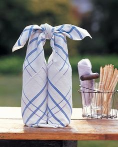 Martha Stewart | Wine Bottle Wrap: Give your hostess two of her favorite bottles of wine, wrapped in an attractive cotton tablecloth that doubles as a carr...