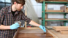 Refinish pressed wood furniture by sanding the shiny veneer surface, applying a couple of coats of primer and finishing with two or three coats of paint. The veneer surface on pressed wood must be...
