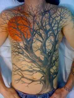 Old tree and sun tattoo on chest , unique tattoo ideas for men