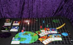 This is the Galaxy Zento adventure board game and where to get your copy:  https://www.thegamecrafter.com/games/galaxy-zento:-chessmen-edition
