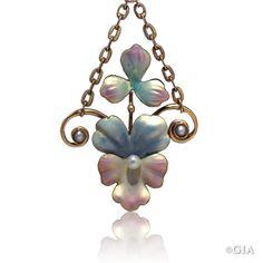 Art Nouveau gold pendant with a pearl. GIA (110414)
