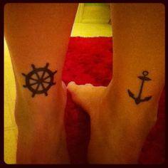 Ship's wheel and anchor