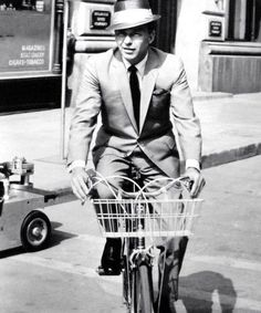 Frank Sinatra rides a bike.  Tags: Come Blow Your Horn Frank Sinatra 1963