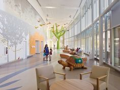"""The entry lobby of nature-themed Nationwide Children's, designed by FKP (Houston), is a light and bright """"aviary"""" with birds, animals, and a cuckoo clock tree to provide positive distractions. Photo: ©Brad Feinknopf."""
