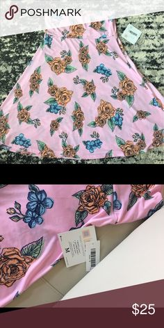 LuLaRoe M Azure Skirt RARE LuLaRoe medium Azure skirt in rockabilly rose pattern. So cute for warm weather! New with tags. Azure retails at $35, asking $25. LuLaRoe Dresses Midi