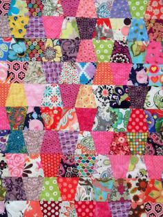 This tumbler sewn quilt was made with using a large variety of fabrics featuring the pink palette. The quilt has a nice aqua border and pink binding. This quilt