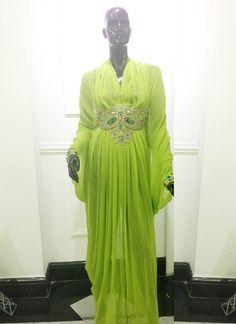 Lime green draped kaftan with beaded waist and wrist applique by Inne Wijaya