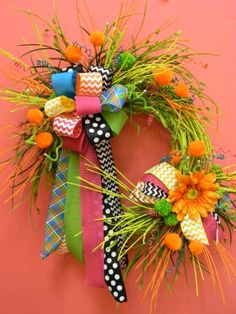 Funkey wreath with pompoms, bows and other  funkey blingshttps://www.facebook.com/pages/Andersons-Interiors/208369055849981! For more go to Anderson's Interiors