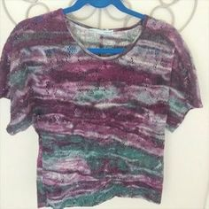I just added this to my closet on Poshmark: Maurices Medium Short Sleeve Purple Popovers. Price: $18 Size: M