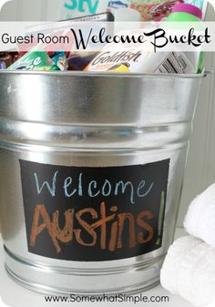 Simple and thoughtful way to welcome your guests- make a bucket for your guestroom with snacks, toiletries, favorite items etc.