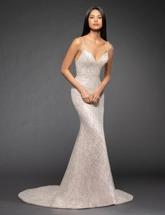 Style 3857 Elisa Lazaro bridal gown - Nude silver shimmer trumpet bridal gown, V-neckline with rhinestone strap detail at open back, chapel train.Also available in IvoryArriving in stores early Fall 2018