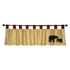 Add the finishing touch to your nursery with this Northwoods Tab Top Window Valance. Cotton valance features a wood grain print in flax and oak with a brow