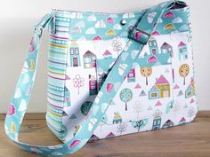 This luxurious baby bag is perfect for carrying all those baby essentials when out and about. It's fully lined and double interfaced for extra strength and durability. Make it for yourself, family, friends or SELL your finished items. Visit MyMisi and buy this pattern! #MyMisi #pattern #bag #tote #baby #cute #design #diy