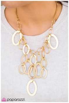 Large gold links and shimmering textured gold rings cascade below a gold chain freely, allowing for movement that makes a bold statement. Features an adjustable clasp closure.   Sold as one individual necklace. Includes one pair of matching earring.