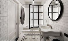 Classic: Continuing the traditiojnal black and white theme, the floors in the bathroom sho...