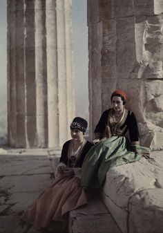 Two women by the Parthenon in the costumes of Crete and Queen Amalie. National Geographic's Greece in Color from the Photographer: Maynard Owen Williams in the