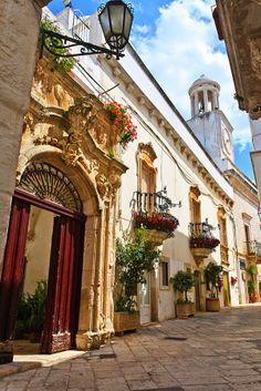 Flower Balconies Against White Walls in Locorotondo, Bari Italy Puglia
