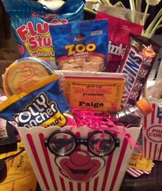 Visit the post for more. Circus Theme, Circus Party, Fundraiser Baskets, Raffle Baskets, Silent Auction Baskets, Fall Carnival, Birthday Basket, Organizing Labels, Themed Gift Baskets