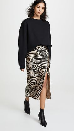 The animal print du jour? Well, according to the Fall 2019 runways, Kendall Jenner and Bella Hadid, it's zebra print. And the stripes even work in spring. Animal Print Outfits, Animal Print Skirt, Animal Print Fashion, Fashion Prints, Printed Skirt Outfit, Printed Skirts, Skirt Outfits, Zebra Print Clothes, Capsule Wardrobe