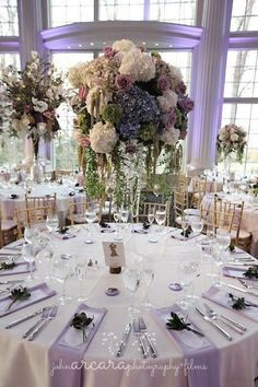 Let this table setting inspire you for your own luxury wedding right down to the purple napkins hanging over the side of the table and the floral piece at each place setting. We designed this for a bride and groom at The Ashford Estate and it was a fairytale dream come true!