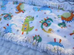 I created this flannel rag baby crib quilt by using all cotton flannels.  This quilt measures 41 x 38 and has been prewashed twice. It will get even softer and softer with each wash.  Awesome blues and grays