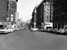 A view looking east down Douglas Street near 18th after it was resurfaced in August 1953. Among the nearby businesses were the Hotel Fontenelle, World Insurance, Penneys, Brandeis, Guarantee Mutual, Herzberg's and the Omaha theater. THE WORLD-HERALD