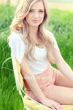I deff want one like this for sure. The   innocence and youth is exactly what I want to convey in my senior   pics!