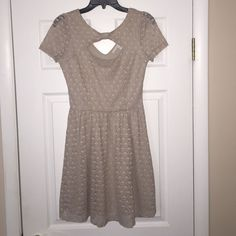 LC Lauren Conrad Lace Dreamer Fit & Flare Dress This beautiful dress has been worn only once! It is in perfect condition. The color is a dark beige and is a size Small. The dress is fit & flare and the material is lace. The top of the front area is open. Last picture is dark, but that is what it looks like on!❤️ Extremely cute dress for many occasions! LC Lauren Conrad Dresses