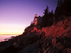 A lighthouse stands at the mouth of Bass Harbor, which shares Maine's Mount Desert Island with Acadia National Park.  [Photo by John Classen, My Shot]