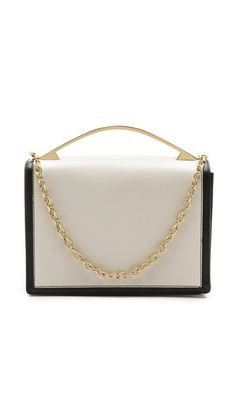 Colorblocked leather gives a sophisticated look to this ZAC Zac Posen clutch. A sturdy gold-tone handle and chain detail the top, and a slim pouch pocket flanks the back. A magnetic top flap opens to a lined accordion interior with 3 compartments and 2 pockets. Dust bag included. @Shopbop