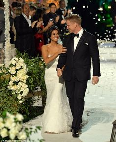 The big day: The couple were wed live on television on Sunday, Neil Lane can be seen in the background cheering pair on. Sean Lowe & Katherine Giudici.