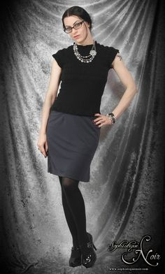 Grey pencil skirt, black shirt, black tights, black ankle boots