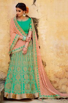 Make a grand statement by wearing this Lehenga Choli having Sea Green colored Silk fabric Lehenga material prettified with zari work and has contrast border. Available with Silk fabric Sea Green colored Choli material and Banarasi Chiffon fabric Light Pink colored contrast dupatta with designer border for a pretty look.