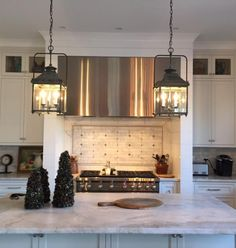 Two Spring Lanterns invite guests to the large kitchen island. Large Kitchen Island, Kitchen Island Lighting, Kitchen Lighting Fixtures, Kitchen Islands, Brass Lantern, Lantern Pendant, Classic Lanterns, New Kitchen, Kitchen Ideas