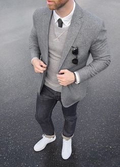 Phil Cohen is sporting a sharp gray on gray look. He throws our slim-fit gray jacquard blazer over a classic white button down, tie, and gray pullover. He keeps the look casual with dark denim and a pair of white sneakers | Banana Republic