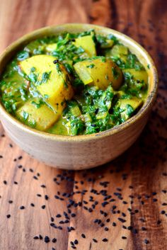 Saag Aloo - a North Indian dish usually made using spinach and potato, though 'saag' is a term also used to describe other greens, such as mustard leaves.