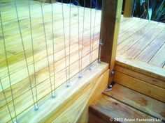 V-Shaped Stainless Vertical Wire Balustrades for Timber Frames by Anzor Architectural