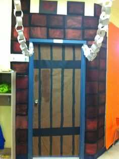 My classroom door for castle theme :)  Instead of paper to make chains, use silver duct tape!