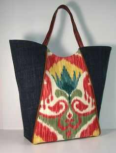 boho ikat and upcycled blue jean upholstery Tote by karenlukacs
