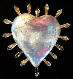 Holiday Artist Collective - Hearts on Fire. Ceramic hearts made by Mary Ann Chubb.