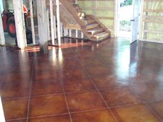 stained concrete to look like tile?  (Looks like your floors Lisa)